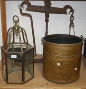 A brass lantern, a brass coal bucket and a set of scales.