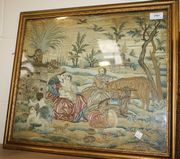 An 18th Century needlework panel with a design of the flight into Egypt with the Madonna and Christ Child with St Joseph amongst livestock, with two putti in the foreground, worked in coloured silks and chenille wools on a cream satin ground, approx 40cm x 47cm, within a gilt frame.