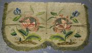An 18th Century ivory-toned damask panel with two embroidered floral sprays, worked in polychrome silk threads with gilt metal thread highlights and with cellular gilt thread border, approx 61cm x 35cm.