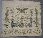A late 18th Century needlework panel, possibly of Turkish manufacture, with a design of a lady flanked by pavilions within a stylized garden with butterfly and various insects, worked in silk threads on a cream canvas ground, approx 34cm x 36cm.