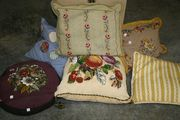 A late 19th Century polychrome bead and gros point cushion with a design of fruit and flowers.
