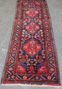 A Hamadan runner, North-west Persia, late 20th Century, the deep blue field with floral medallions supported by guls, within a stepped leaf and flowerhead border, approx 306cm x 100cm.