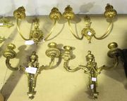 A pair of 19th Century gilt cast bronze twin branch wall lights of neoclassical design, height approx 28cm, together with a similar pair of Hepplewhite style wall lights with oval backplates, height approx 25cm.