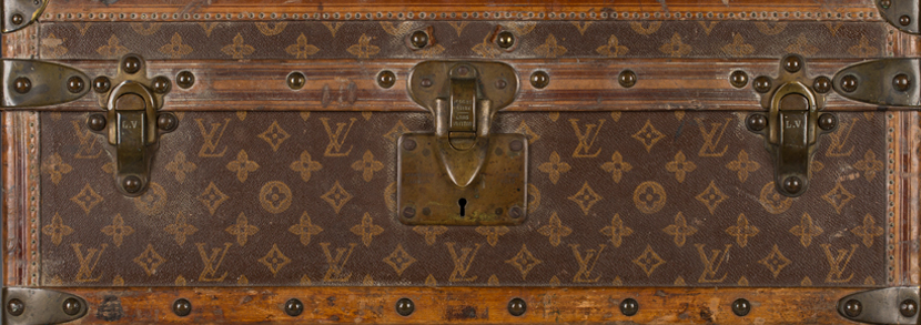 A late 19th/early 20th century Louis Vuitton travelling trunk with overall monogram and quatrefoil decoration on a brown ground