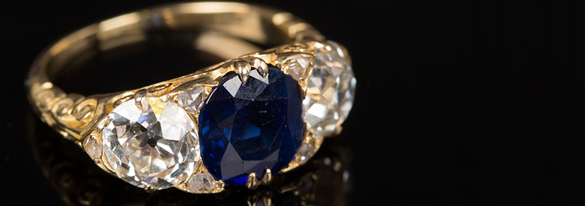 A gold, sapphire and diamond set three stone ring Hammer price: £9,000