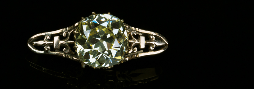 A large old mine cut cushion shaped fancy light yellow diamond