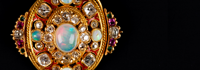 A gold, diamond, opal, ruby and emerald oval pendant Hammer price: £2,400