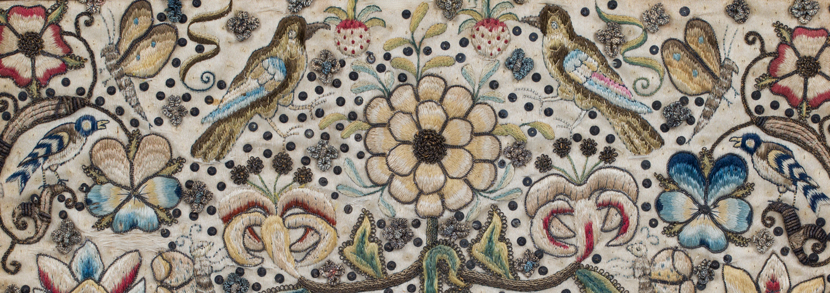 Late 17th century metal thread and silk needlework panel depicting overall stylized plants, flowerheads, fruit, scrolling tendrils, birds and butterflies