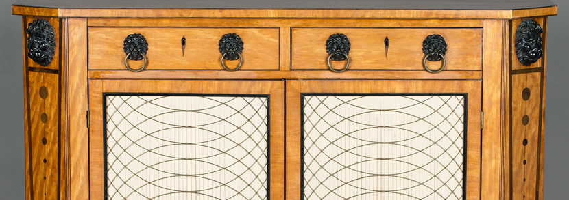 A late George III satinwood and ebonized side cabinet, the crossbanded top with boxwood and ebony stringing