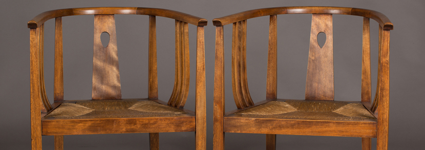 A pair of Arts and Crafts Glasgow School tub back armchairs, designed by E.A. Taylor