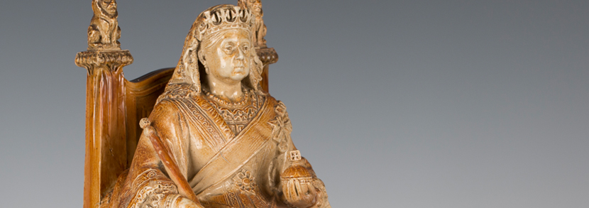 A Doulton & Co salt glazed stoneware commemorative figure of Queen Victoria, by John Broad, circa 1901