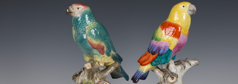 Two ormolu mounted Meissen porcelain parrots