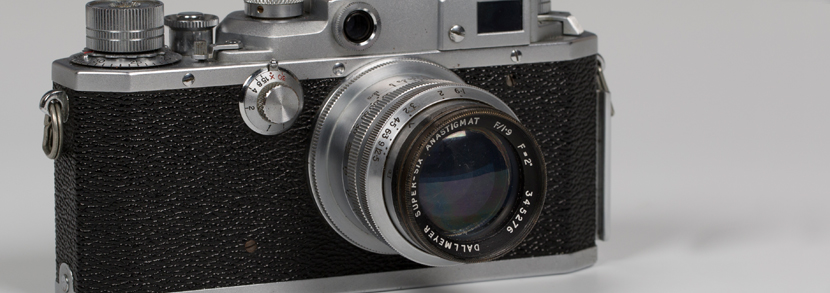 A Dallmeyer Super-Six Anastigmat F/1.9 F=2 lens, serial No. 345276, together with a Canon camera