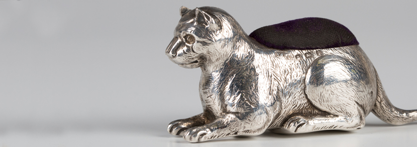 Edwardian silver novelty pin cushion in the form of a recumbent cat, Birmingham 1908 by Adie & Lovekin Ltd