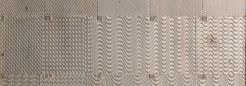 A Carl Faberg� silver guilloch� engraving pattern sample panel, early 20th century