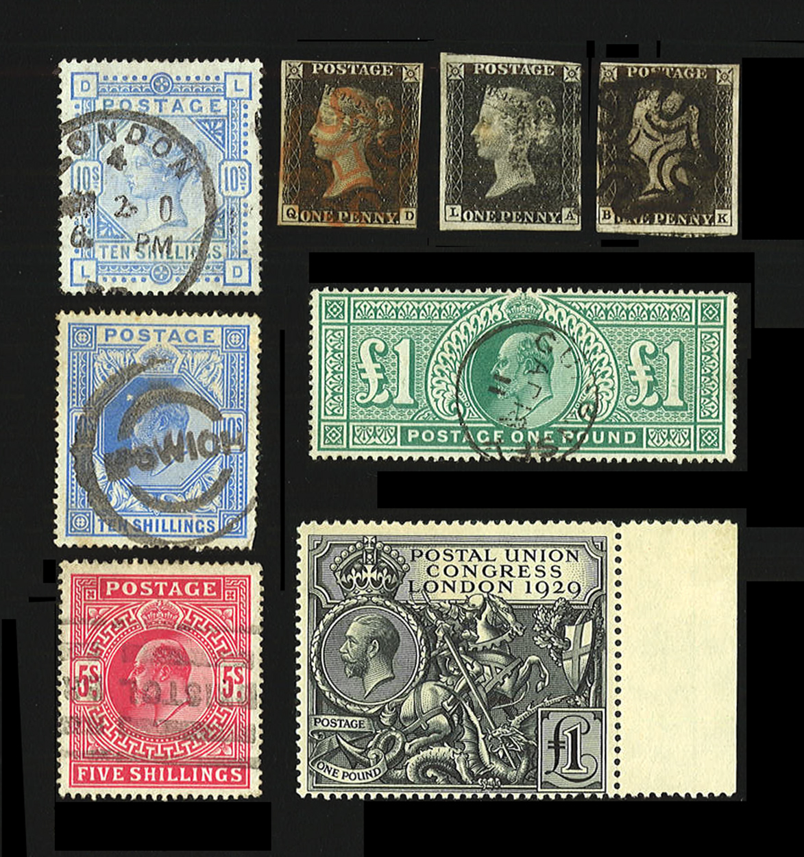 Four Windsor stamp albums containing Great Britain stamps