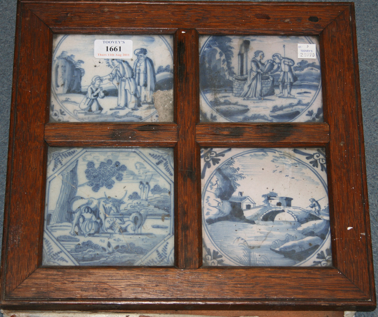 Four Dutch delft blue and white tiles, mid-18th Century
