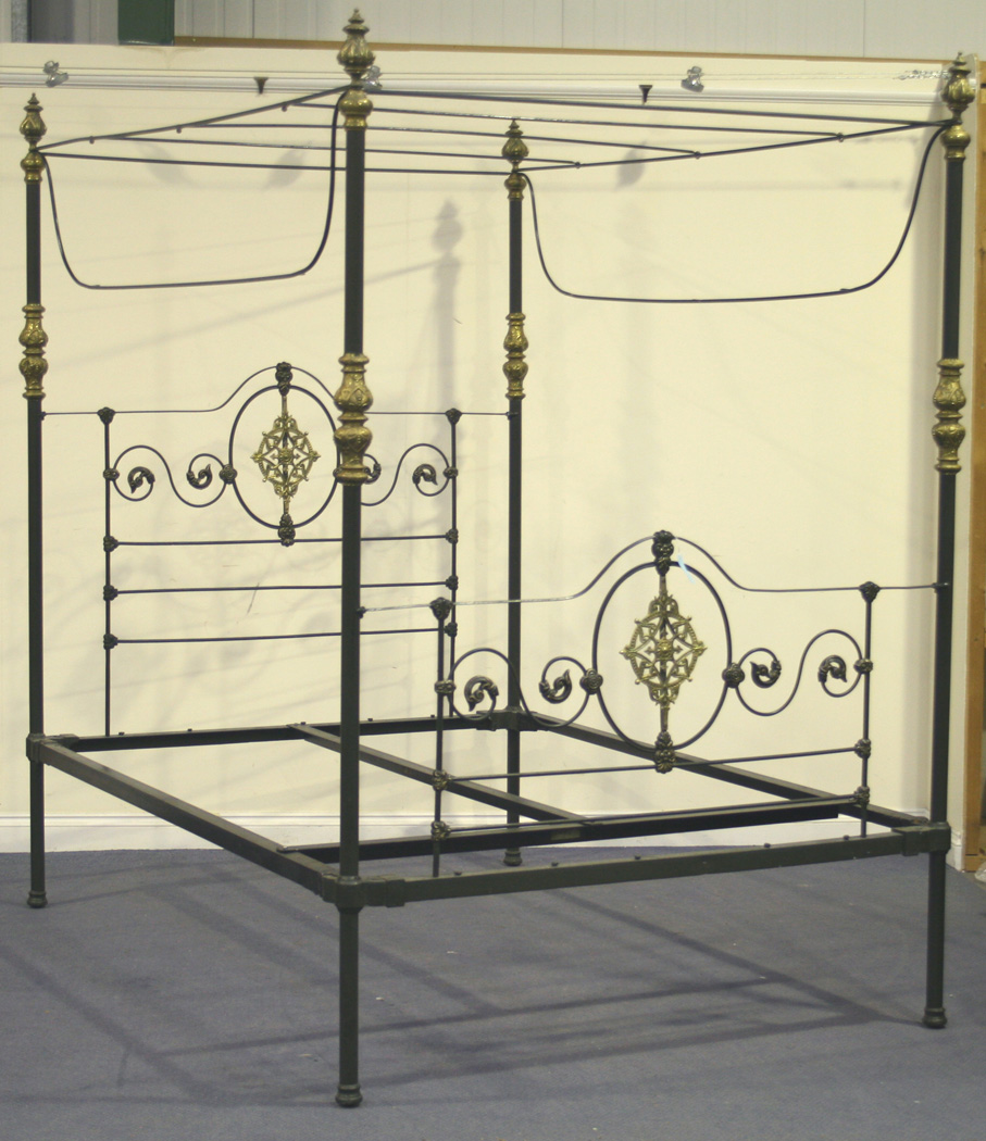 A Victorian And Later Cast Iron And Brass Mounted Four Poster Bed With Anthemion Embossed Finials An