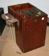 A Siebe Gorman & Co dynamo electric detonator, the wooden case with a leather carrying handle.