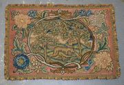 A late 19th Century petit and gros point panel with a design of a dog within an oval landscape, after the needlework panel executed by Mary Queen of Scots, within a stylized flower border, worked in coloured and gilt threads and coloured wools, approx 45cm x 32cm.