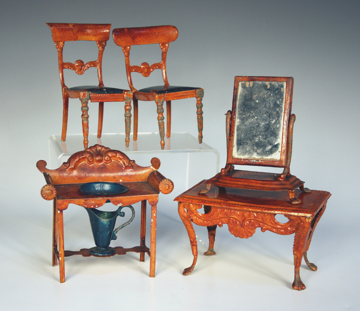 A Mid 19th Century Suite Of Tinplate Doll 39 S House Furniture Possibly By Evans Cartwright Of Wo