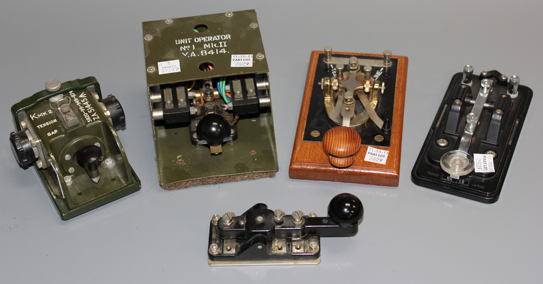 Two military Morse keys, a Hi-Mound Morse key and two other