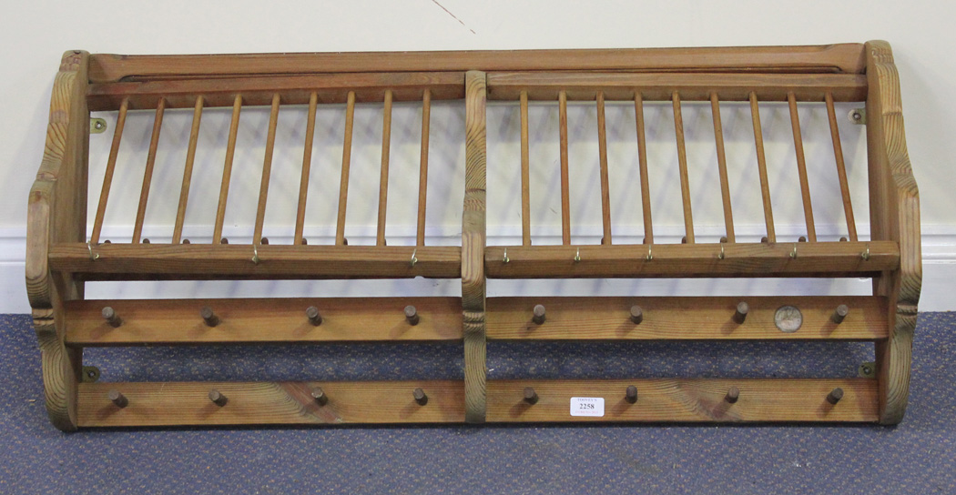 A modern Penny Pine Company wall mounted plate rack inset with a 1963 copper penny width approx 96 & A modern Penny Pine Company wall mounted plate rack inset with a ...