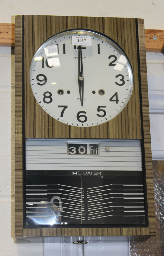 A 1960s Seiko 4pc Time Dater Wall Clock With 30 Day