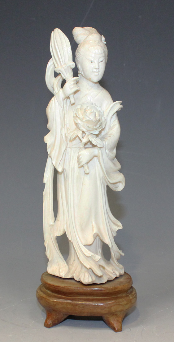 bb0c353af A Chinese carved ivory figure of a maiden