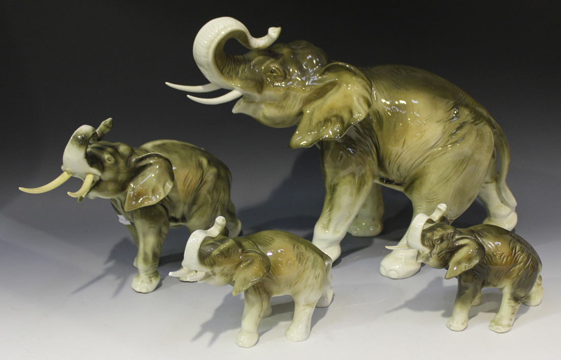 A group of four graduated Royal Dux porcelain elephants, all with
