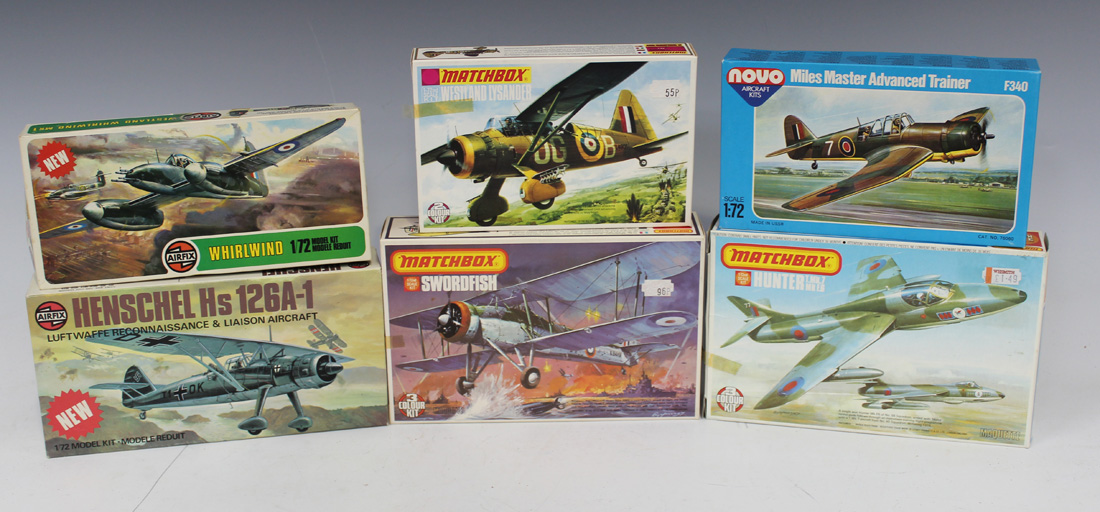 A collection of plastic model aircraft kits, including
