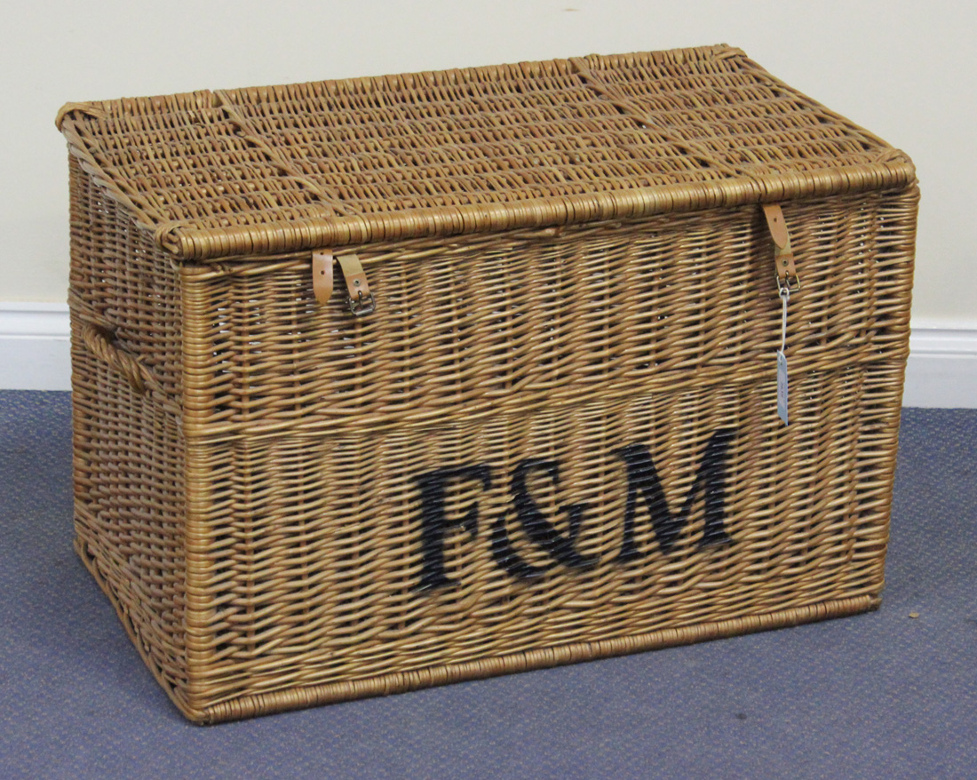 A Wicker Basket With Hinged Lid The