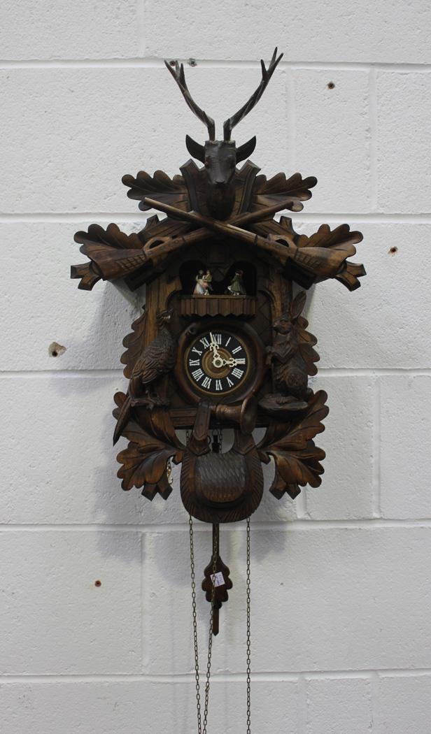 A modern Reuge softwood cased cuckoo clock with Edelweiss