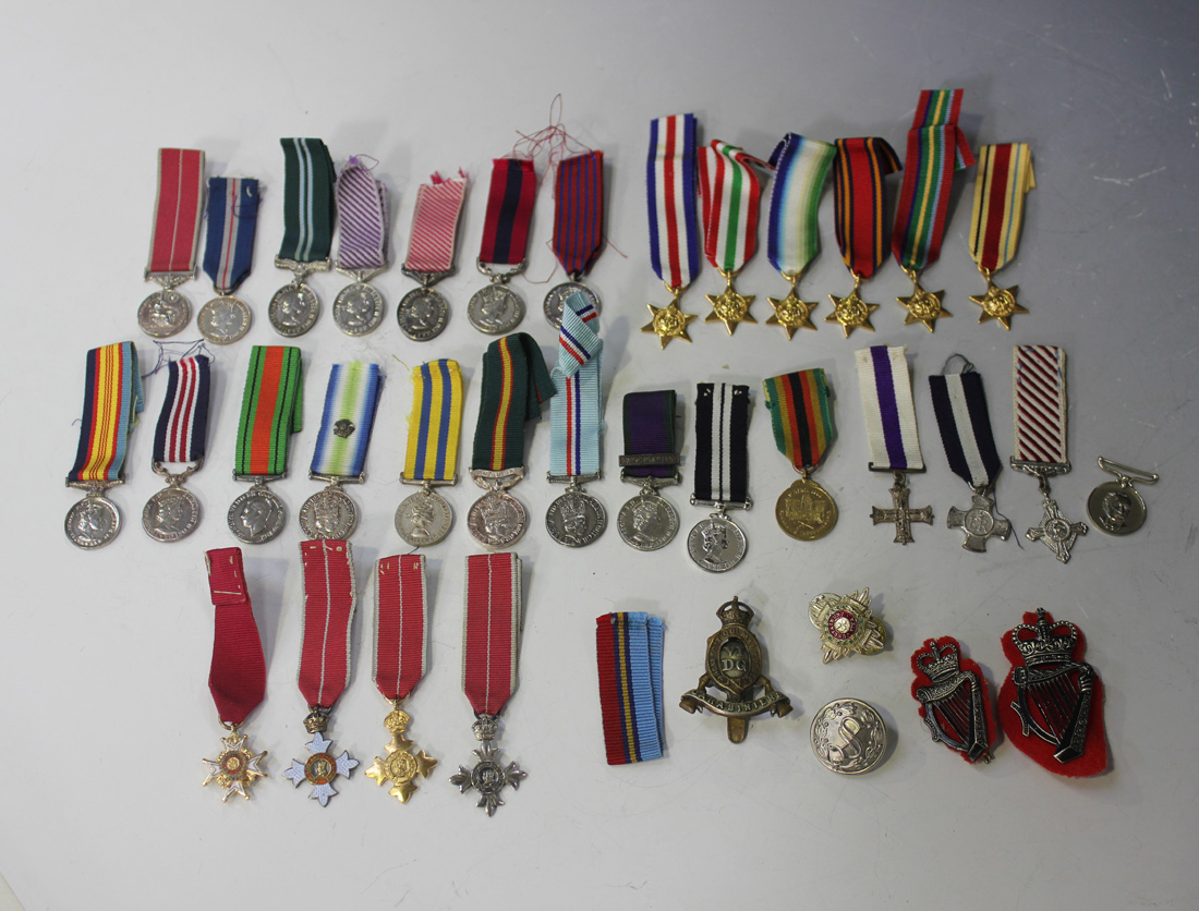 Thirty-one mostly British modern dress miniature medals, including