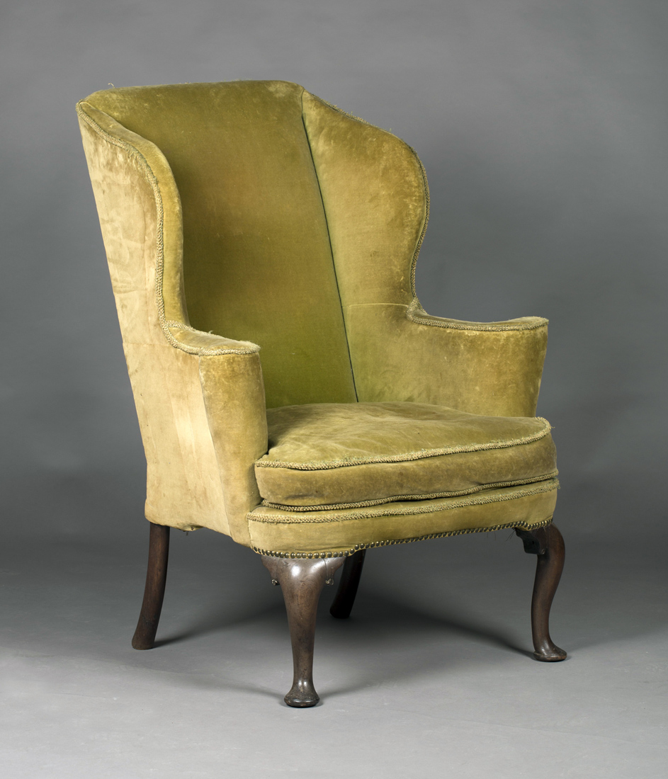 A Queen Anne Wing Back Armchair Upholstered In Green Velour The Curved Seat With Loose Cushion Fla