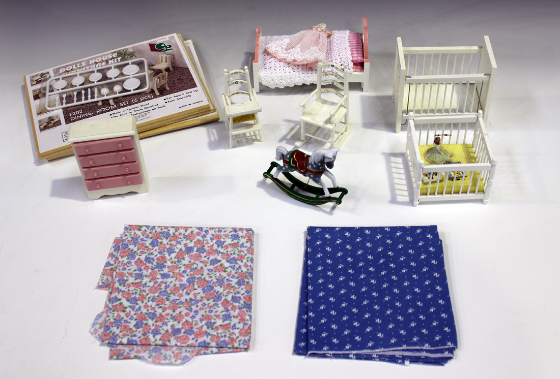 A collection of mostly modern dolls house accessories and furniture including a four post bed