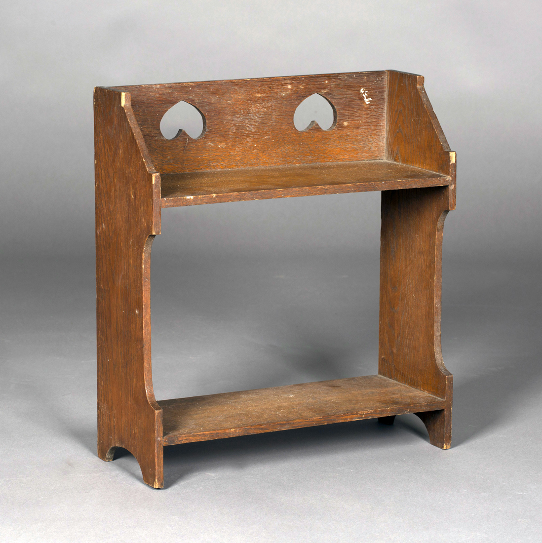An Edwardian Arts And Crafts Oak Two Tier Bookshelf The Gallery Back With Pierced Inverted Hear