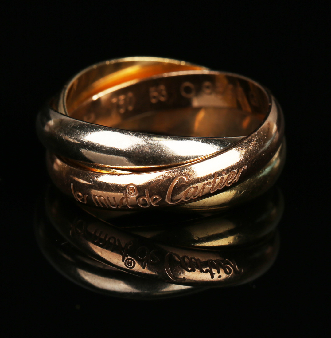 c7696185ebf5c A Les Must de Cartier 18ct three colour gold triple band Russian ...