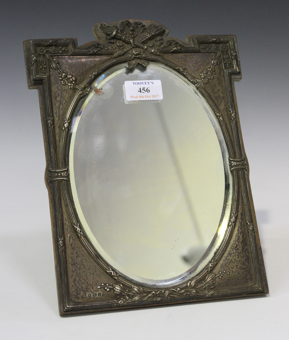 An Edwardian silver mounted dressing table mirror, the frame