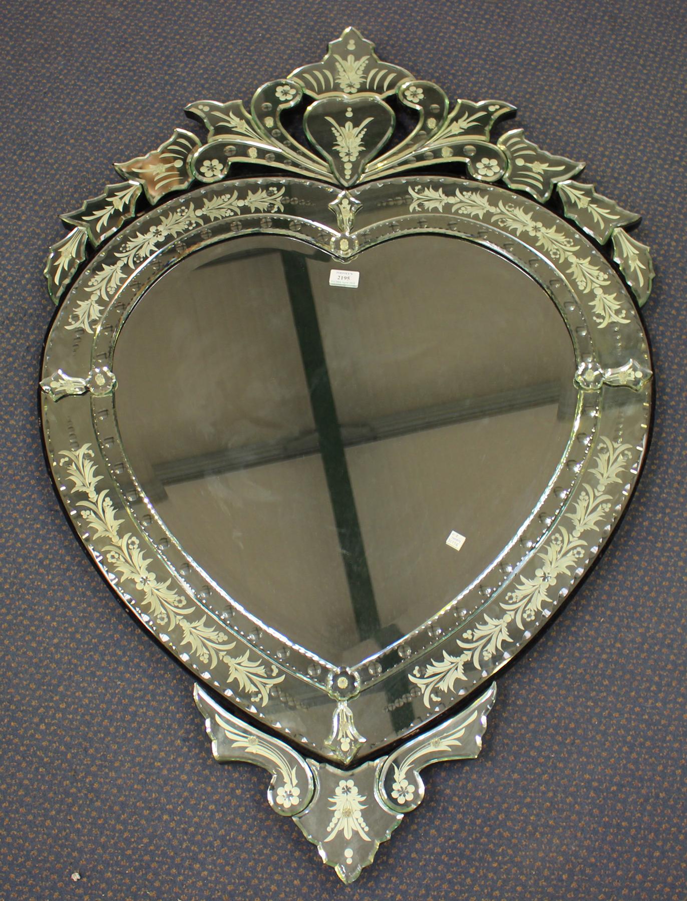 A 20th century Venetian style wall mirror of heart shaped ...