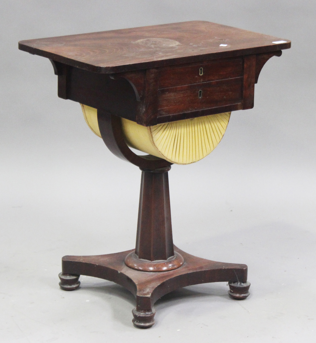 An early Victorian mahogany work table fitted with two ...