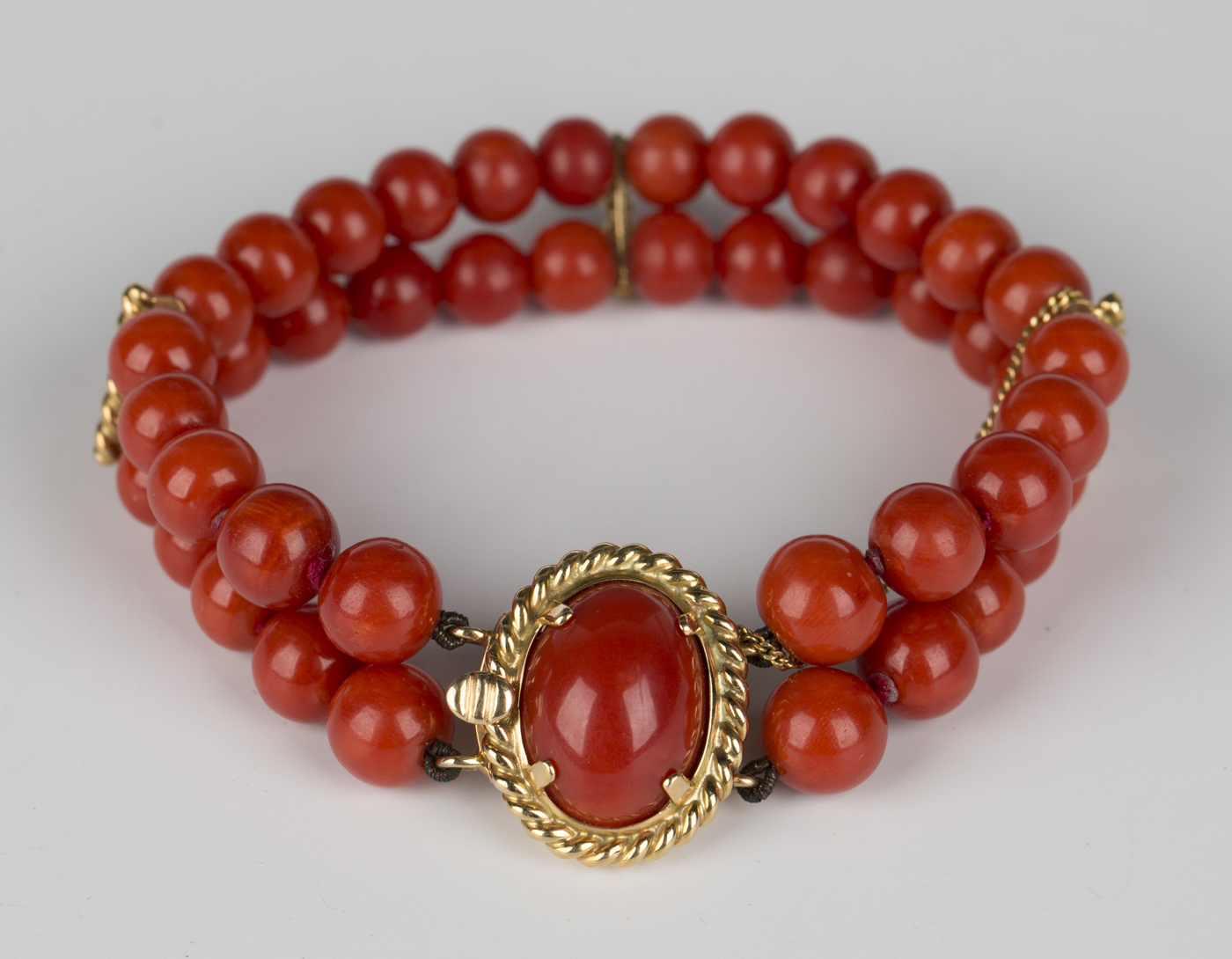 7c3445dcddae0 A two row bracelet of slightly graduated coral beads on an oval gold ...