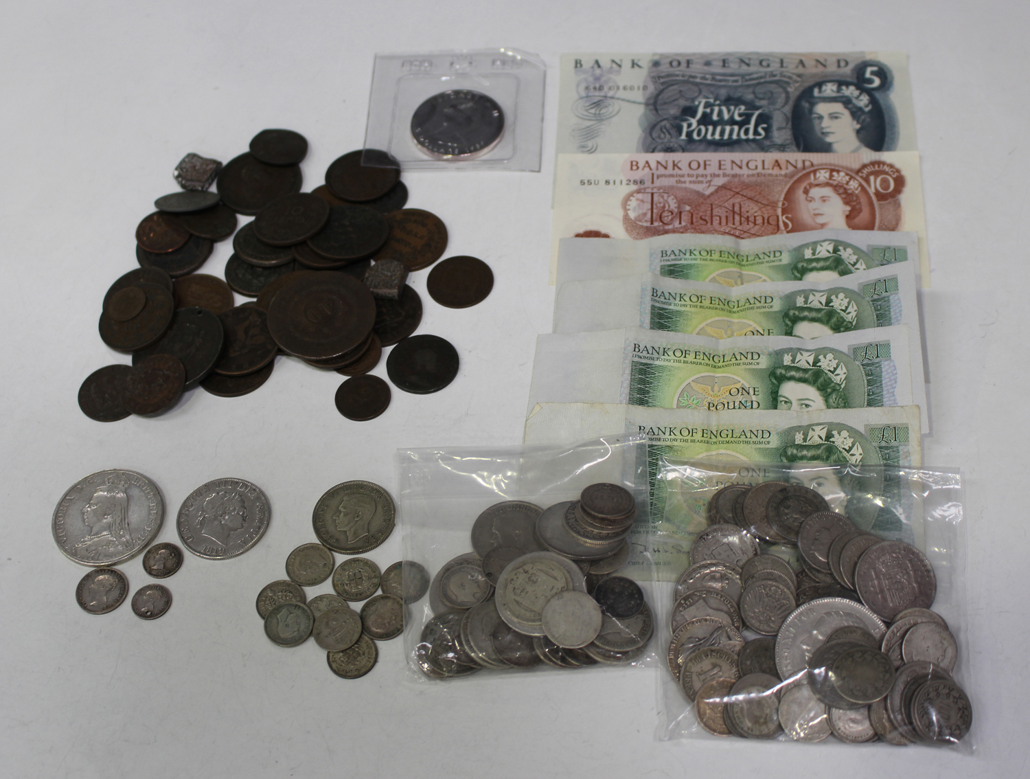 A small collection of British and world coins, including a